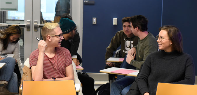 Students share a conversation in a political sciences classroom