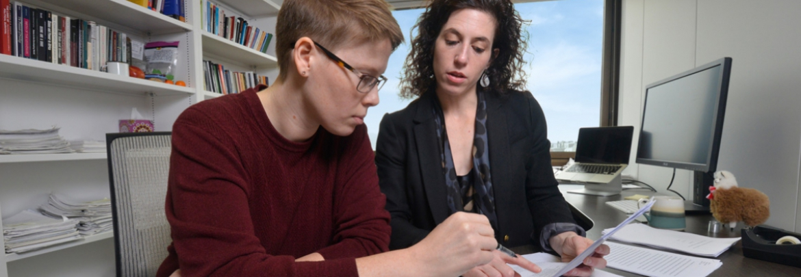 A professor and student work together on an assignment.